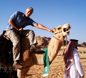 "Robert Atwater meets a camel during the  ""Messengers of Peace"" meeting in Saudi Arabia."