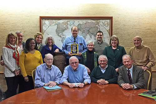 At desk, from left: Bruce Blanchard, treasurer, Jack Williams, chair, Bill Runyon, secretary, Lee Talbot; sanding from left; Cindy Steuart, Mike Manyak, Arnella Trent, Carole Baker, Lonnie Schorer, Tony Meunier, Betsy Steuart, Michael Wyrick, Polly Penhale, Jay Kaplan, 2011-2013 chair