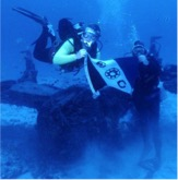 Harry with Dr. Hayes Wilson submerged in Midway Atoll; EC Flag 146