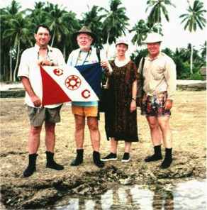 Harry Brooks, MED93-Sweeney; Dr. Thorn Winter, MN89; Susan Davis, MN 90; DR. Joe Rude, MN83 with TEC Butaritari Flag 146