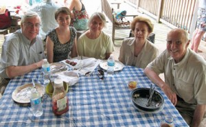 Some of those at the picnic on the deck overlooking the pool. Photo by Patricia McGeehan